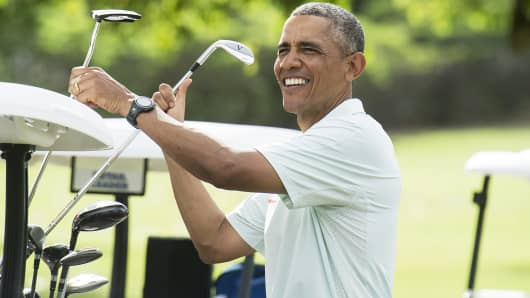 President Barack Obama jokes with reporters as he plays golf with Malaysian Prime Minister Najib Razzak at Marine Corps Base Hawaii, Dec. 24, 2014.