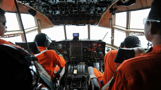 Air Force personnel seen aboard Hercules aircraft during a search operation in Selat Karimata, Belitung, Indonesia on December 29, 2014, to find the AirAsia missing plane.