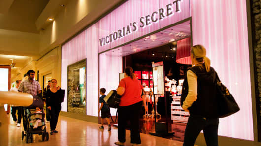 Shoppers pass by a Victoria's Secret store.