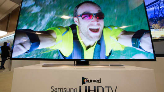 Samsung Electronics curved Ultra High Definition televisions are displayed at a media event in Seoul, South Korea, last February.