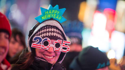 Revelers celebrate New Year's Eve in Times Square on December 31, 2014 in New York City.