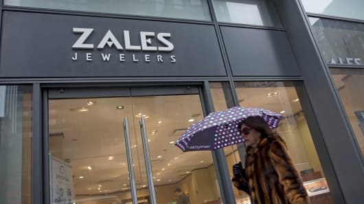 A woman walks past a Zales store in New York, Feb. 19, 2014.