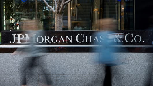 Pedestrians pass in front of the JPMorgan Chase headquarters building in New York.
