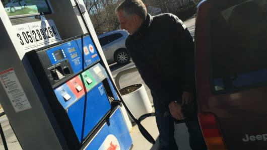 A man fills up for under $3 a gallon in Salisbury, CT on Jan. 1, 2015.