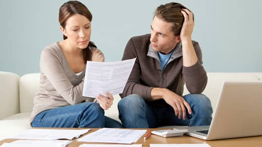 Young couple personal finances bills debt