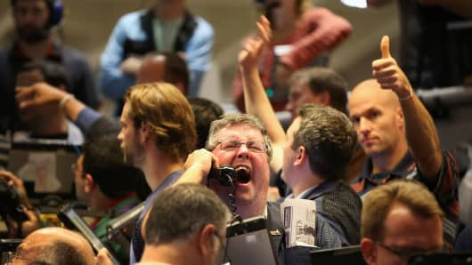 Traders signal offers in the Standard & Poor's 500 stock index options pit at the Chicago Board Options Exchange (CBOE) following the Federal Open Market Committee meeting in Chicago, Illinois.
