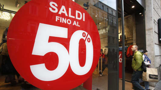 "A poster advertises ""Up To 50% discount"" in Rome, Italy"