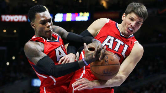 Dennis Schroder and Kyle Korver of the Atlanta Hawks go after a rebound during the NBA game at Staples Center on January 5, 2015 in Los Angeles.