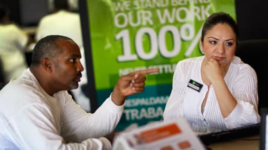 A man attempts to do his taxes at an H&R Block office with the help a tax professional.