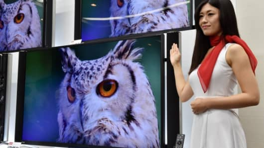 A model displays Japanese electric maker Mitsubishi Electric's new 4K television in Tokyo.