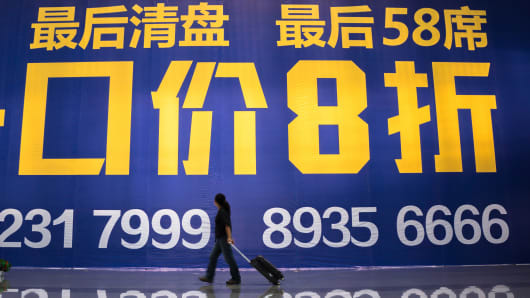 A huge house price discount advertising billboard is seen at a railway station in Xi'an, China.