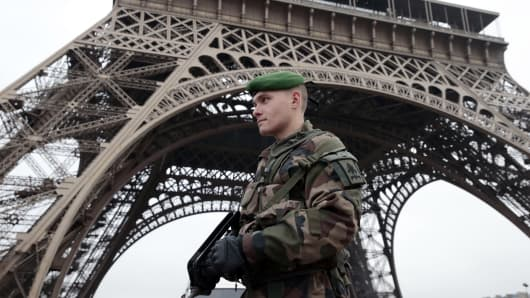 A soldier on guard at the Eiffel Tower in Paris on January 7, 2015.
