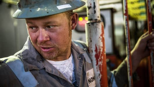 An oil worker in the Bakken shale formation outside Watford City, North Dakota.