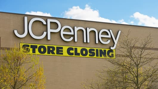 A JC Penny department store with a store closing banner last April.