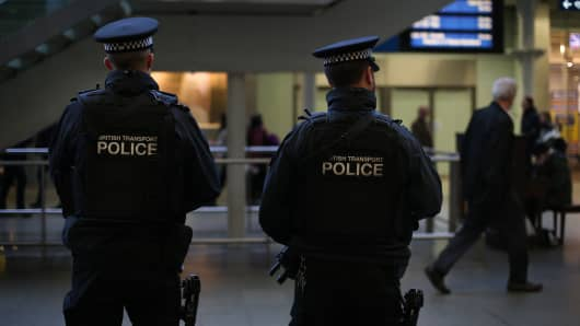 Armed British Transport Police officers patrol the Eurostar platforms at St Pancras railway station in London.