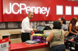 Customers checking out at JC Penney store