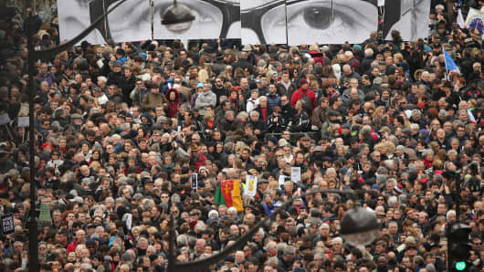 Demonstrators gather in Place de la Republique prior to a mass unity rally to be held in Paris following the recent terrorist attacks.