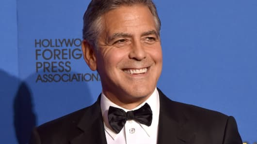George Clooney, recipient of the Cecil B. DeMille Award, in the press room during the 72nd Annual Golden Globe Awards at The Beverly Hilton Hotel on January 11, 2015 in Beverly Hills.