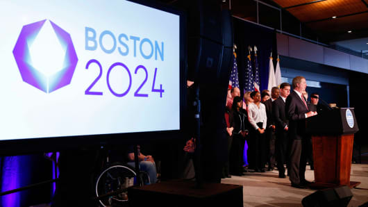 United States Olympic Committee president Lawrence F. Probst III, flanked by Boston mayor Martin J. Walsh (left) , talks about the USOC selecting Boston as its applicant city to host the 2024 Olympic and Paralympic Games during a press conference at the Boston Convention Center and Exhibition Center last Friday.