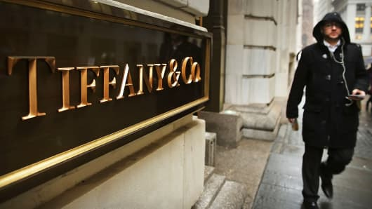 A man walks past a Tiffany & Co. store along Wall Street in New York, Jan. 12, 2015.