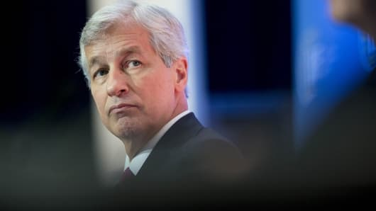 JP Morgan Chase Chairman and CEO Jamie Dimon listens during an Institute of International Finance panel discussion in Washington, Oct. 10, 2014.