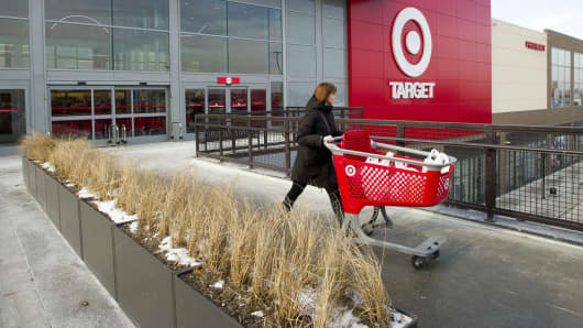 A woman pushes a shopping cart as she leaves a Target Corp. store in Toronto, Ontario, Canada, on Thursday, Jan. 15, 2015. Target Corp. will walk away from Canada less than two years after opening stores there, putting an end to a mismanaged expansion that racked up billions in losses.