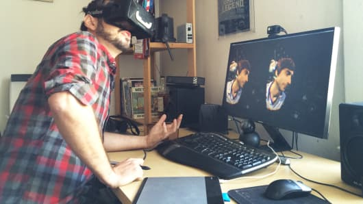 Drew Skillman works with Tilt Brush, a virtual reality tool that he and co-founder Patrick Hackett (on screen) created for designers and artists.