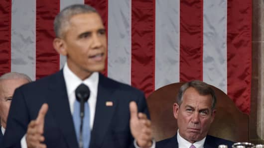 Speaker of the House John Boehner (R) listens to President Barack Obama deliver the State of the Union address on January 20, 2015 in the House Chamber of the U.S. Capitol in Washington, DC.