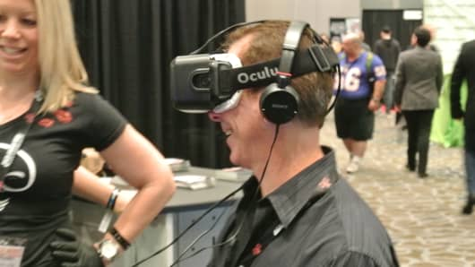 An attendee at the 2015 Adult Entertainment Expo in Las Vegas demos the Oculus virtual reality glasses.