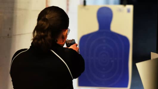 A woman fires a gun at the Ultimate Defense Firing Range and Training Center in St Peters, Missouri last November.