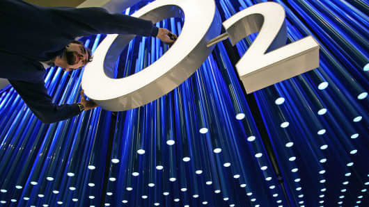 A man works on the stand of mobile operator O2 at the CeBIT fair grounds in Hanover, Germany, in this March 6, 2006 photo.