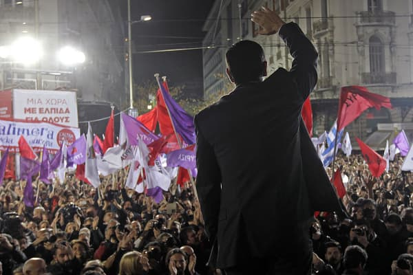 Alexis Tsipras, opposition leader and head of the leftist Syriza party, waves at supporters during a campaign rally in central Athens, Greece, Janu. 22, 2015.