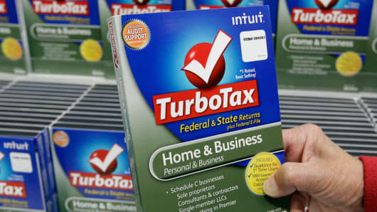 Customer looks at a copy of TurboTax on sale at Costco in Mountain View, Calif.