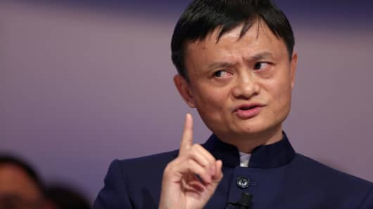 Jack Ma, billionaire and chairman of Alibaba Group Holding Ltd., gestures as he speaks during a session on day three of the World Economic Forum (WEF) in Davos, Switzerland, on Friday, Jan. 23, 2015.
