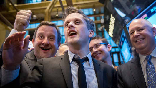 Box co-counders Aaron Levie (C) and Dylan Smith (2nd R) celebrate their company's IPO on the floor of the New York Stock Exchange, Jan. 23, 2015.