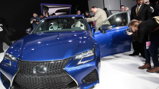 Members of the media look over the 2016 Lexus GS F at the North American International Auto Show in Detroit, January 13, 2015.