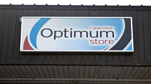 Signage is displayed outside of a Cablevision Systems Corp. Optimum store in the Brooklyn borough of New York.