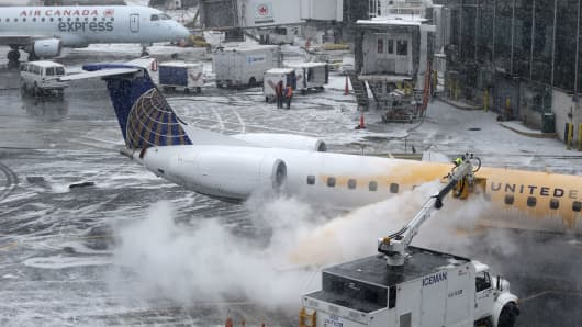 A plane is de-iced at LaGuardia Airport in New York, Jan. 26, 2015.