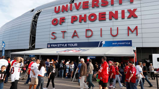 Fans walk outside University of Phoenix Stadium on January 25, 2015 in Phoenix.