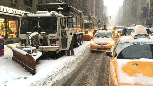 A line of snow plows prepares to battle the blizzard on Lexington Ave in New York City on Jan. 26, 2015.