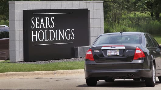 A sign marks the entrance to the headquarters campus of Sears Holding in Hoffman Estates, Illinois.