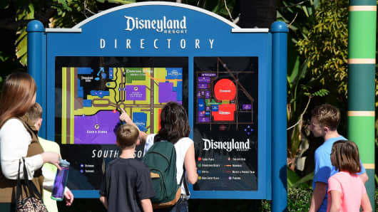 People visit Disneyland on Jan. 22, 2015 in Anaheim, California.