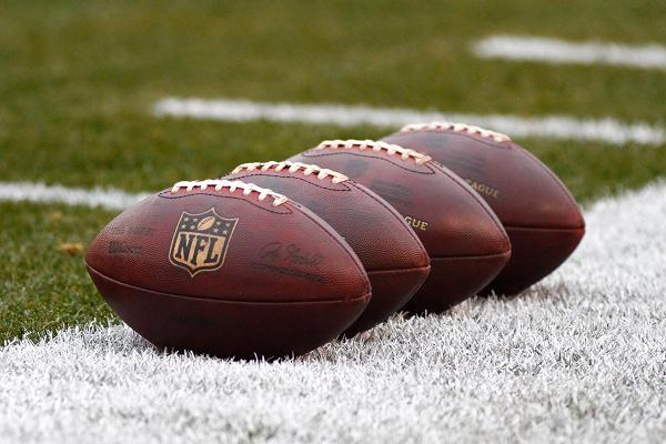 Wilson NFL footballs on field.