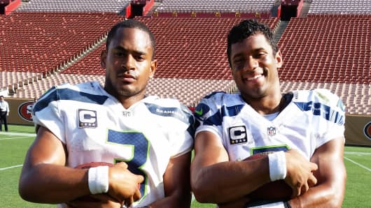 Seattle Seahawks' Russell Wilson, right, with his commercial stunt double Randall Bacon.