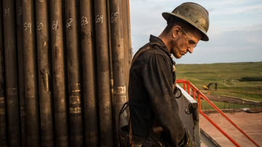 A floorhand works on an oil rig in the Bakken shale formation outside Watford City, North Dakota.