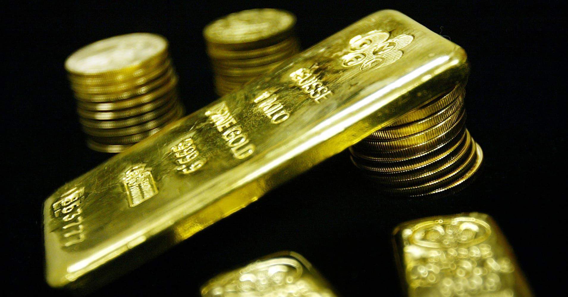 Gold hits more than six-week high as dollar, stocks slip