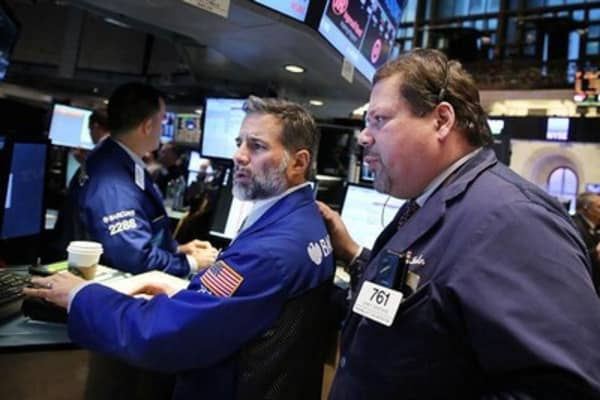 Wall Street seeks positive end to ugly month