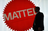Man silhouetted against Mattel sign
