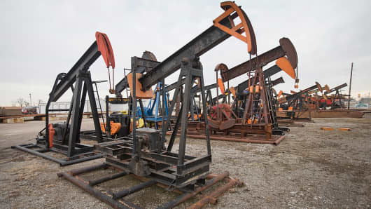 Idled oil well pump jacks sit in the yard at Wood Energy Inc. in Woodlawn, Ill, Jan. 20, 2015.