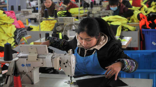 An employee works at a garment factory, which exports products to Europe, in Hefei, Anhui province January 19, 2015.